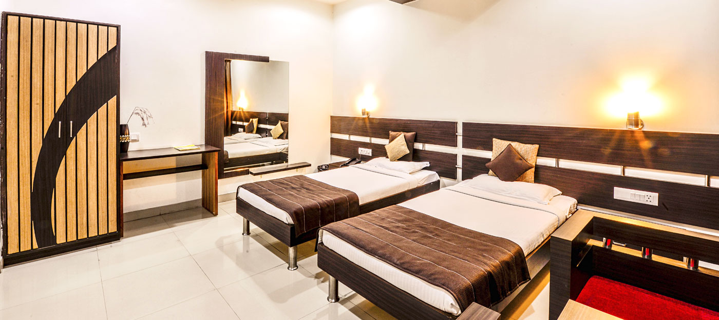 spacious twin bed room at 3 star hotels in Udaipur